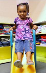 Girl on slide at Children's Clothing Exchange